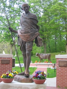 Gandhi-statue-with-Emily-Memorial-in-background1-e1431138446967-225x300