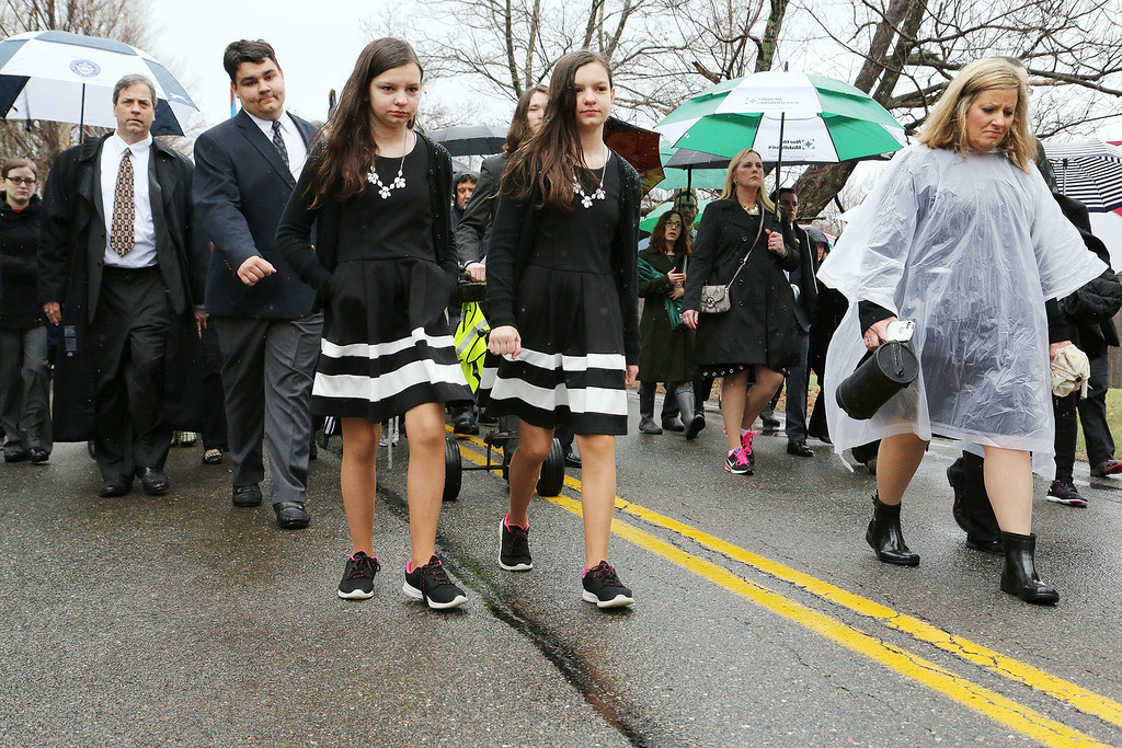 "A funeral was held for Rosemary E. ""Betsy"" Sawyer on Tuesday morning in Shirley. After a ceremony at the Bull Run her casket was loaded onto a caisson and pushed up to Center Cemetery in Shirley for burial. waling just in front of the caisson is twins Jill and Kate Suchecki, 12, seventh graders at Groton Dunstable Middle School who where members of Sawyers Bookmakers and Dreamers Club. SENTINEL & ENTERPRISE/JOHN LOVE"