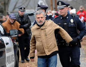 Lewis Randa being arrested during civil disobedience action on Inauguration Day in Sherborn.