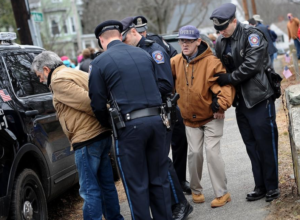Randa and Woods being arrested following civil disobedience action in Sherborn.