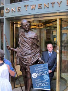 Statue of Gandhi blocking entrance to Goldman Sachs in Boston